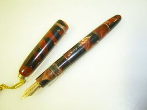 Montegrappa ringtop, #302 red marbled button filler