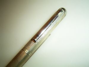 Mario Valentino oversize silverplated pencil